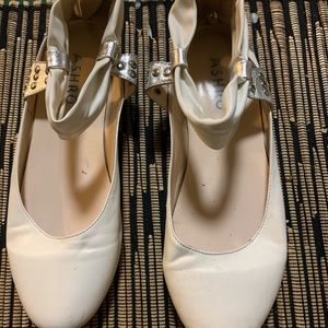 White and gold flat shoes